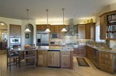 modern kitchen,granite countertops,island,tail backsplash,stainless appiances,spacious